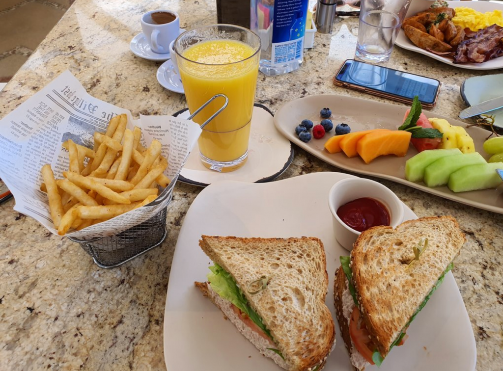A breakfast sandwich on a plate Description automatically generated
